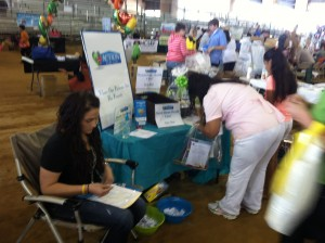 Okeechobee County Health & Safety Expo attendees stopping at Action Home Care's booth.
